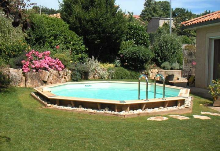 Piscine en bois oc a octogonale distripool for Piscine hors sol a enterrer